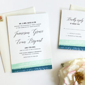 Romantic wedding invitations with watercolor brushstroke detail and modern, elegant calligraphy.
