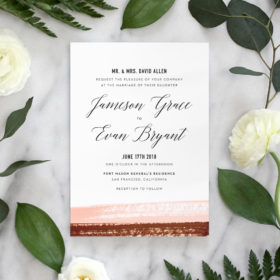Watercolor wedding invitation suite features elegant, modern calligraphy and textured watercolor brushstrokes in blush and copper.